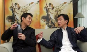 "Action movie stars Jet Li, left, and Jackie Chan chat during a joint interview in Beijing Monday, April 14, 2008. The two are in Beijing for the world premiere of their movie ""The Forbidden Kingdom"" on Wednesday. (AP Photo/Greg Baker)"