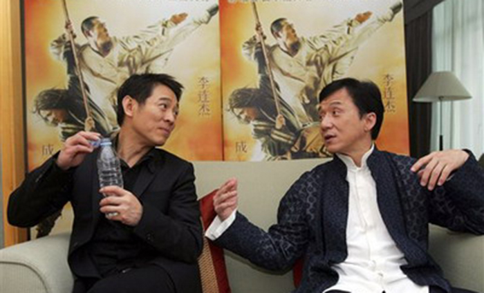 """Action movie stars Jet Li, left, and Jackie Chan chat during a joint interview in Beijing Monday, April 14, 2008. The two are in Beijing for the world premiere of their movie """"The Forbidden Kingdom"""" on Wednesday. (AP Photo/Greg Baker)"""